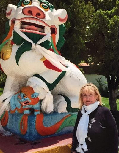 Posing next to a Dragon Statue in Nepal