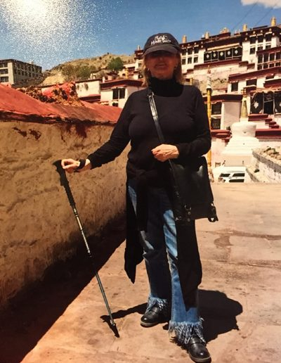 Carrying a walking stick and ready to hike up Everest