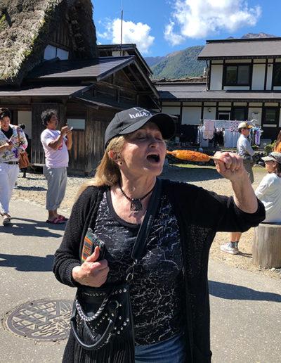 Dr. Miller snacking on rice cake stick in Kanazawa, Ishikawa