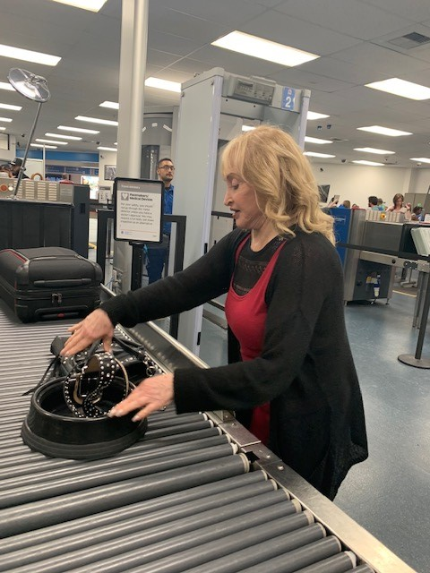 Dr. Miller going through security on her way to Austin